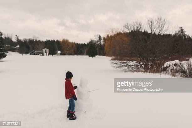 girl playing in snow - peterborough ontario stock photos and pictures