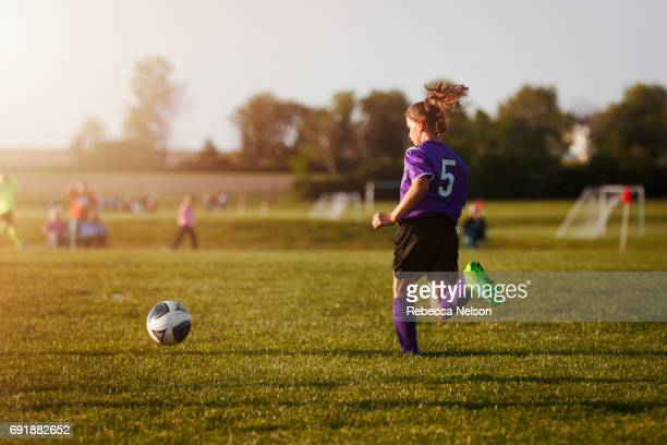 girl playing in soccer game - rebecca nelson stock pictures, royalty-free photos & images