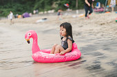 asian girl playing beach
