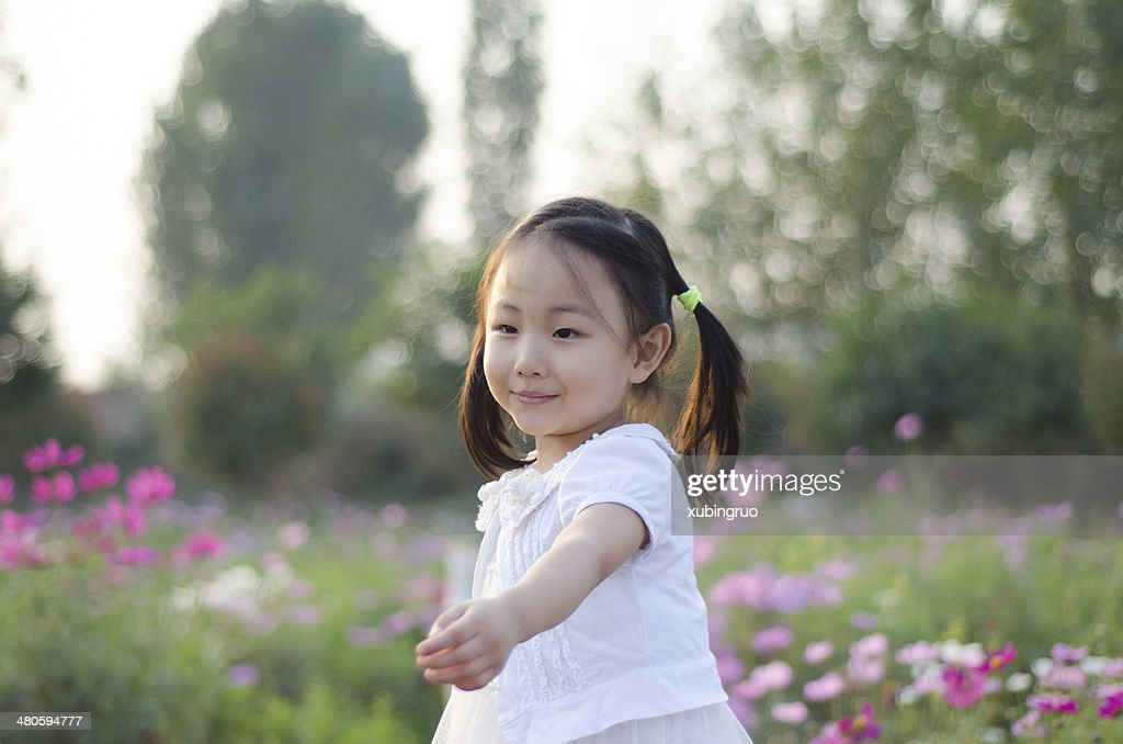 Girl playing in the garden : Stock Photo