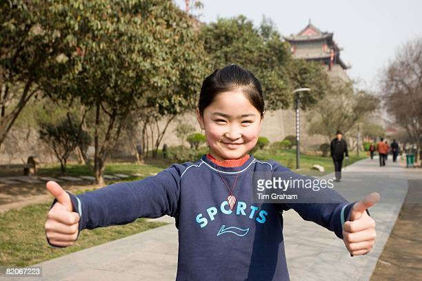 Girl playing in the park by the City Wall Xian China has a one child policy to limit population