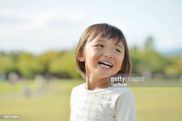 girl playing in the park - childhood stock pictures, royalty-free photos & images