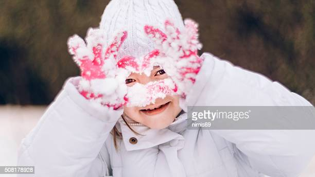 Girl (6-7) Playing in The Snow