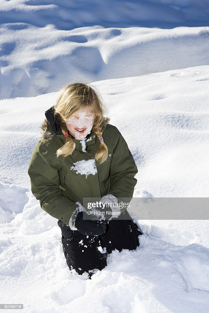 A girl playing in the snow. : Stock Photo