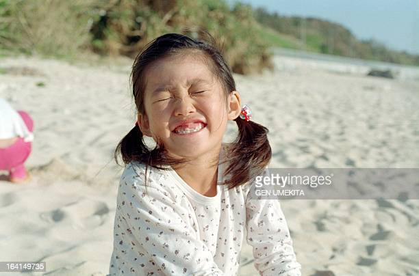 Girl playing on a beach