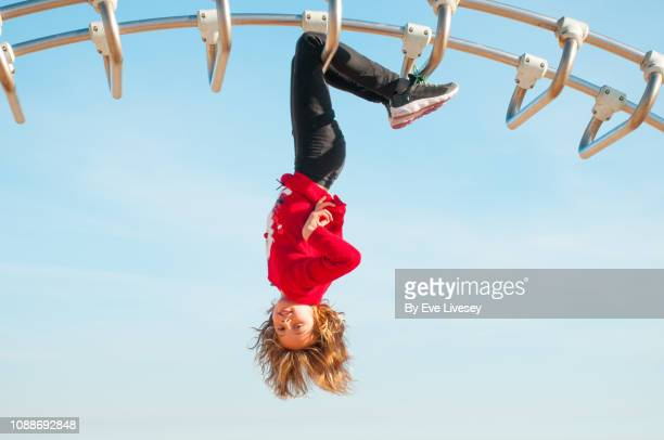 girl playing on a climbing frame - metallic shoe stock pictures, royalty-free photos & images