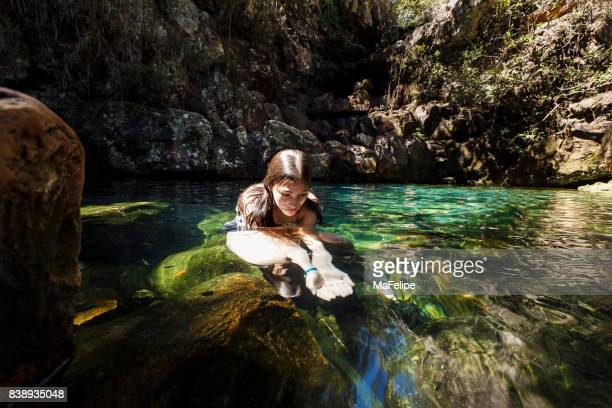 girl playing on a pond - goias stock pictures, royalty-free photos & images