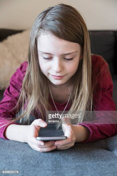 girl playing on a smartphone
