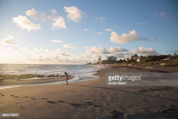 girl playing on beach, blowing rocks preserve, jupiter island, florida, usa - jupiter island stock photos and pictures