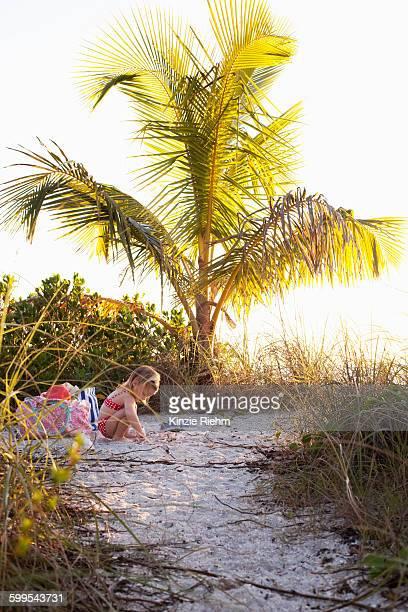 Girl playing on beach, Sanibel, Florida, USA