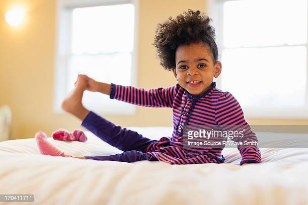 Girl playing on bed