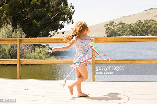 Girl playing on jetty