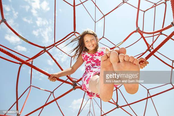 Girl playing on ropes outdoors