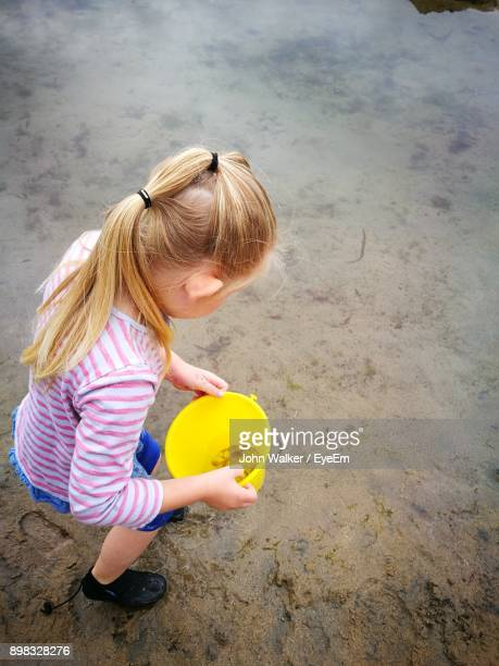 Girl Playing On Sand At Beach