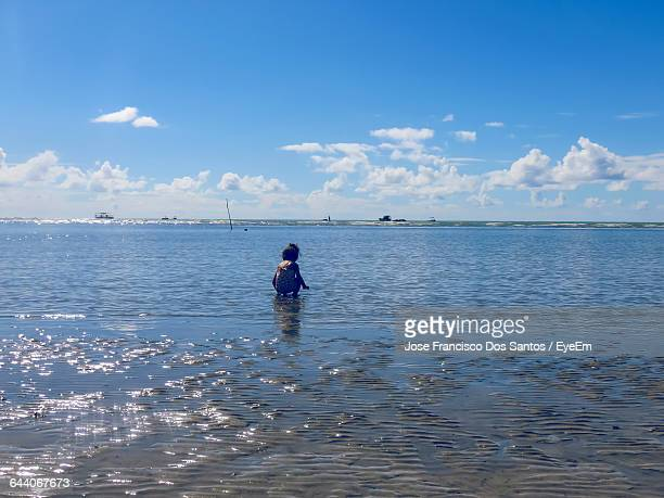Girl Playing On Sea Shore During Summer