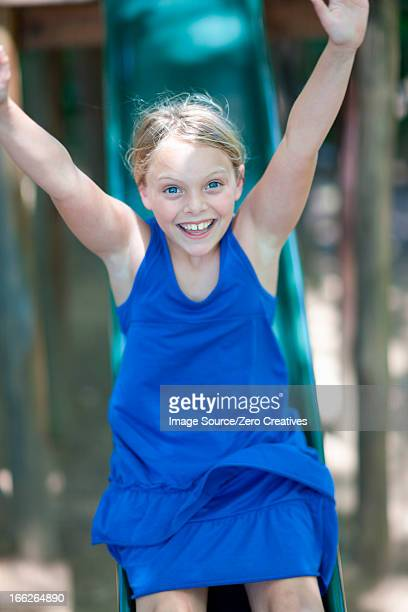 girl playing on slide outdoors - 滑る ストックフォトと画像