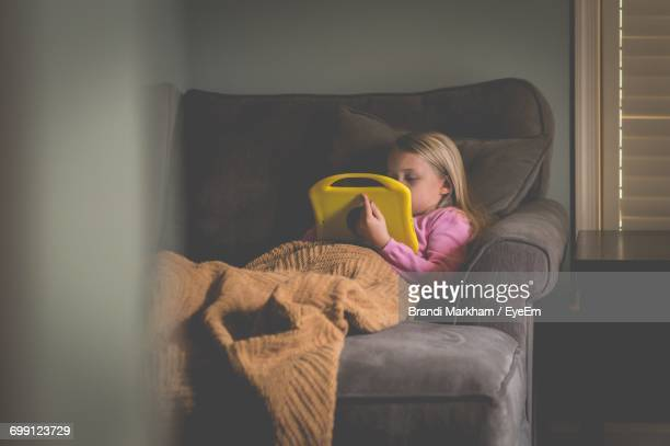 Girl Playing On Sofa