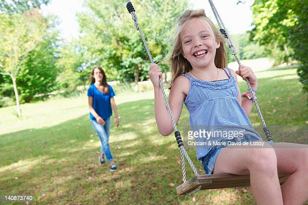 girl playing on swing in backyard - saint ferme stock photos and pictures