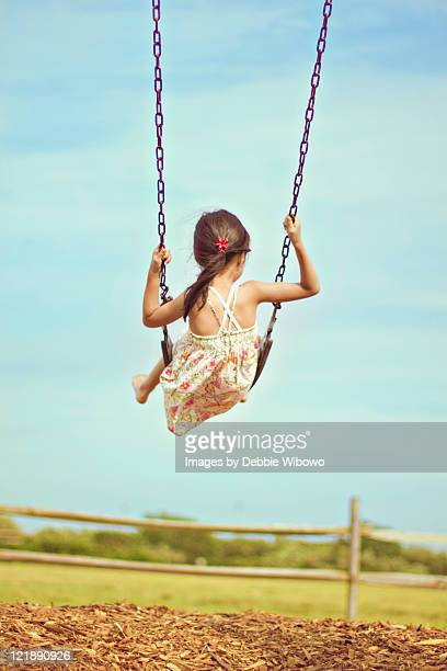 Girl playing on swing