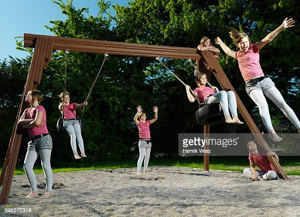 girl playing on swing set - repetition stock pictures, royalty-free photos & images