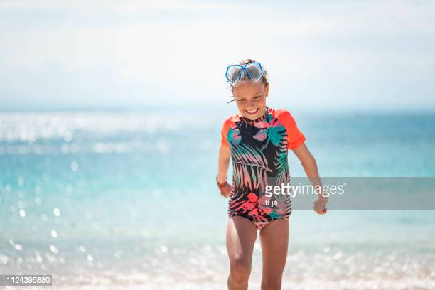 girl playing on the beach - scuba mask stock pictures, royalty-free photos & images