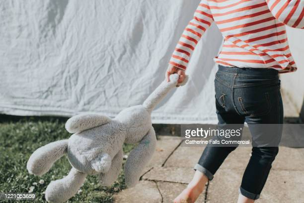 girl playing outside - teddy bear stock pictures, royalty-free photos & images