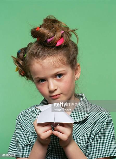 Girl playing paper game