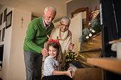 young girl playing christmas carols piano