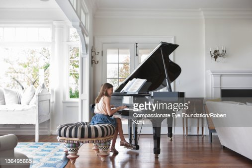 Girl Playing Piano In Living Room Stock Photo Getty Images