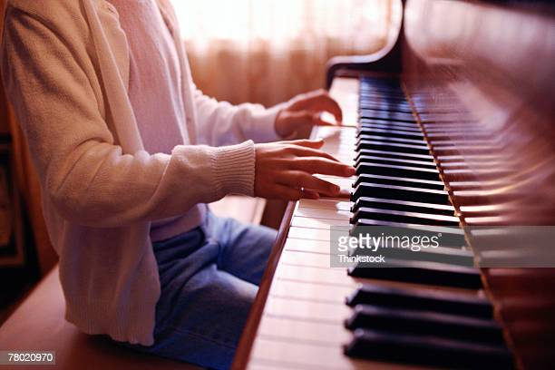 girl playing piano - thinkstock stock photos and pictures