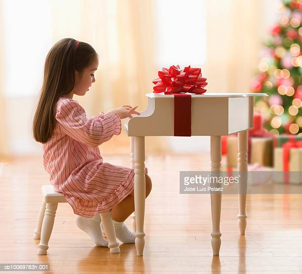 Girl (4-5) playing piano