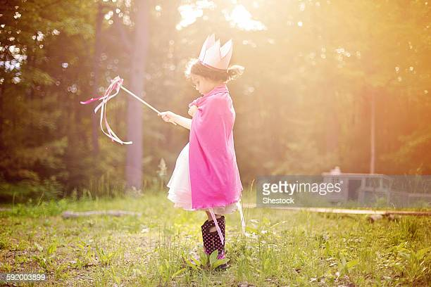 girl playing princess in backyard - princess stock pictures, royalty-free photos & images