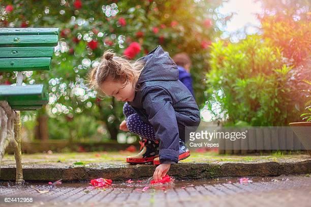 girl playing puddles