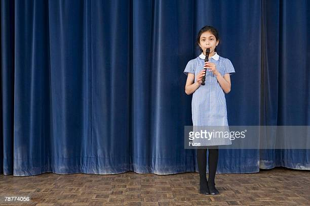 Girl Playing Recorder