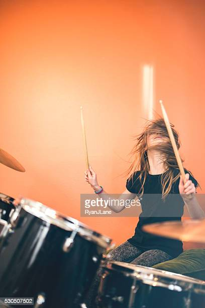 girl playing rock and roll drums - percussion instrument stock photos and pictures
