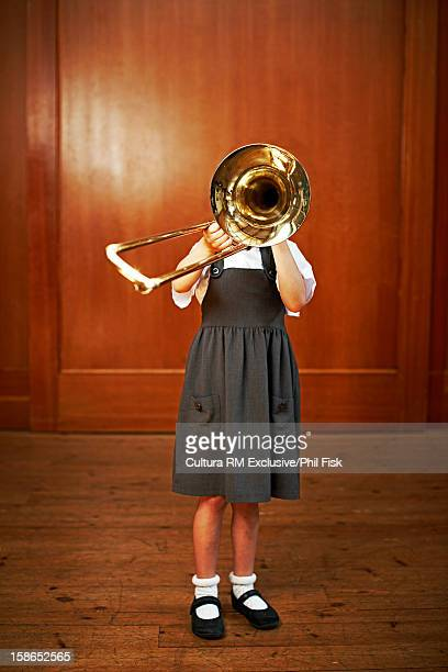 Girl playing slide trombone
