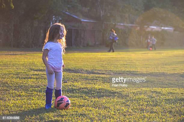 Girl playing soccer.