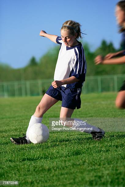 girl playing soccer - blue balls pics stock pictures, royalty-free photos & images