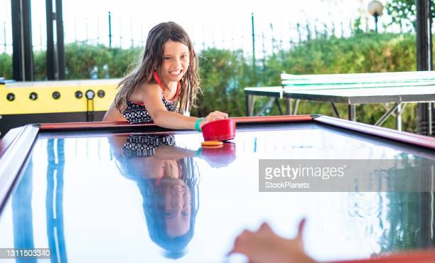 girl playing table hockey - shooting at goal stock pictures, royalty-free photos & images