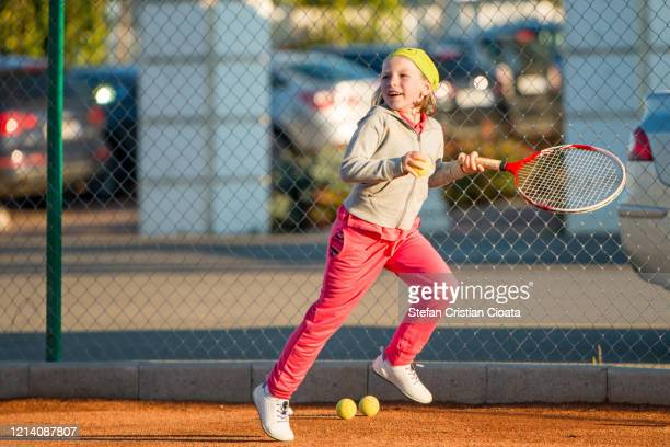 girl playing tennis at school - racquet stock pictures, royalty-free photos & images