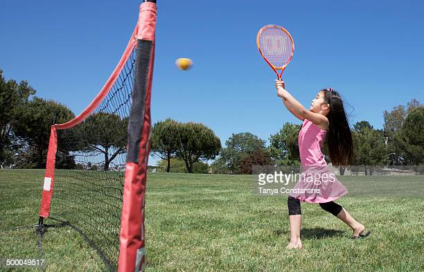 Girl playing tennis in park