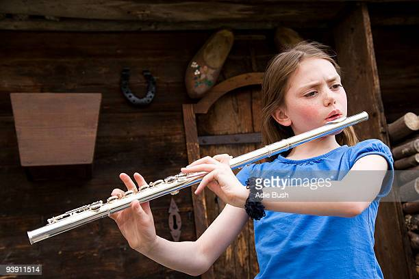 Girl playing the flute.