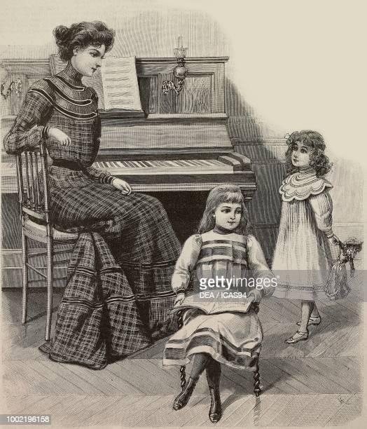 A girl playing the piano in a checkered dress an 89 year old girl with notebook and a 34 year old girl with doll models by Mademoiselle Louise Piret...