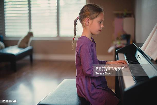 girl playing the piano - electric piano stock photos and pictures
