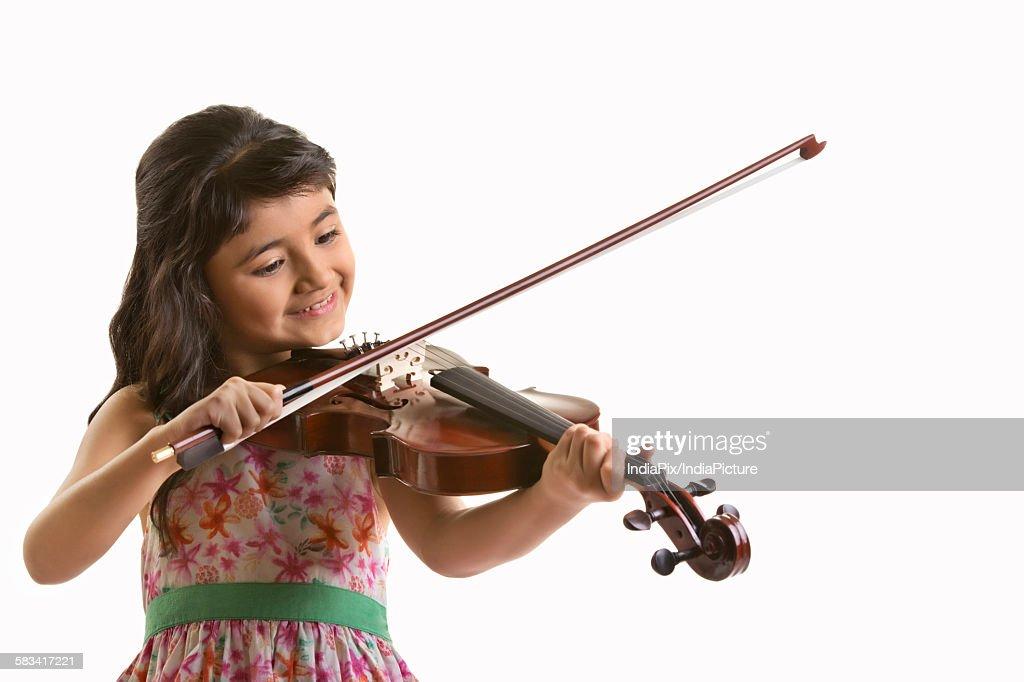 Girl playing the violin : Stock Photo