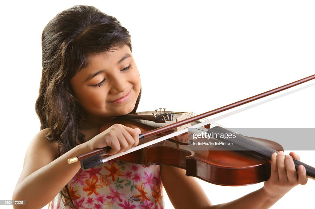 Girl playing the violin : Stock Photo