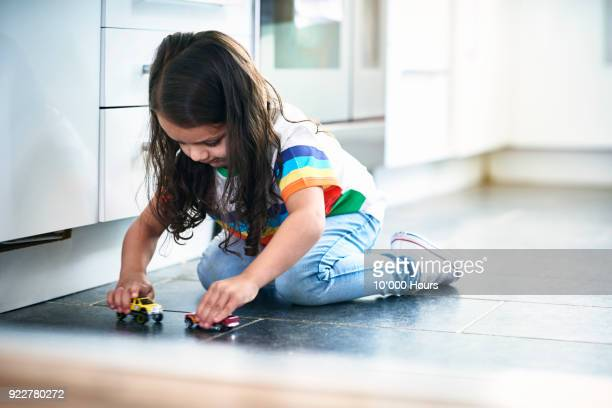 girl playing toy cars - toy stock pictures, royalty-free photos & images