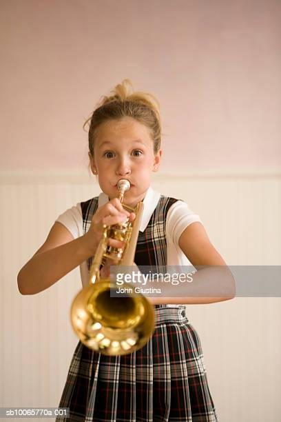 Girl (10-11) playing trumpet, portrait