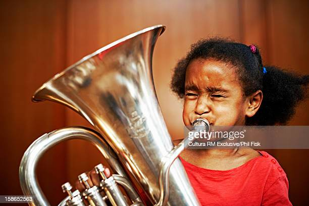 girl playing tuba - effort stock pictures, royalty-free photos & images