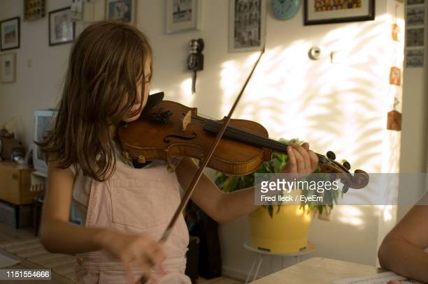 girl playing violin at home - violin stock pictures, royalty-free photos & images